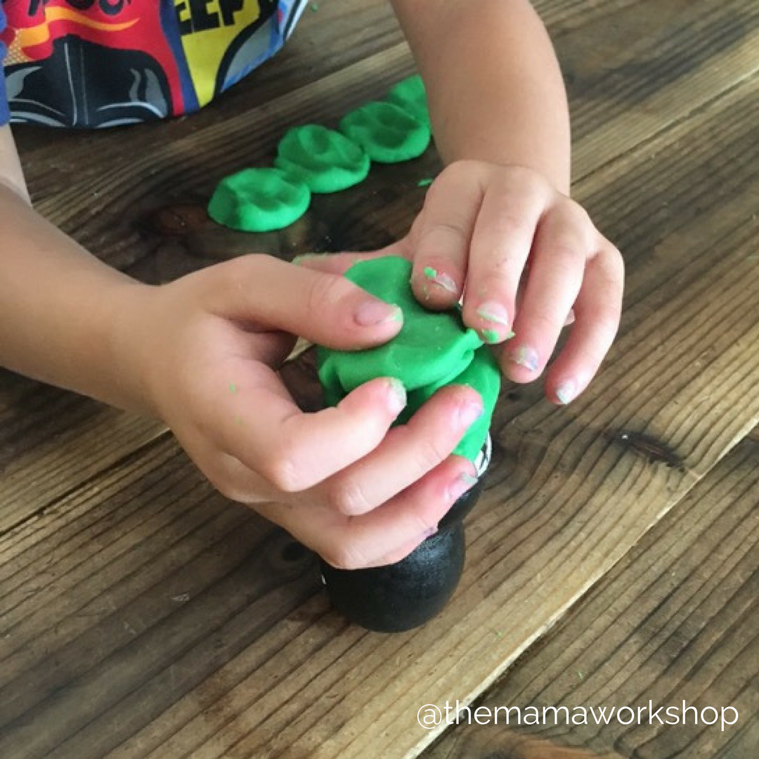 stacking green playdoh